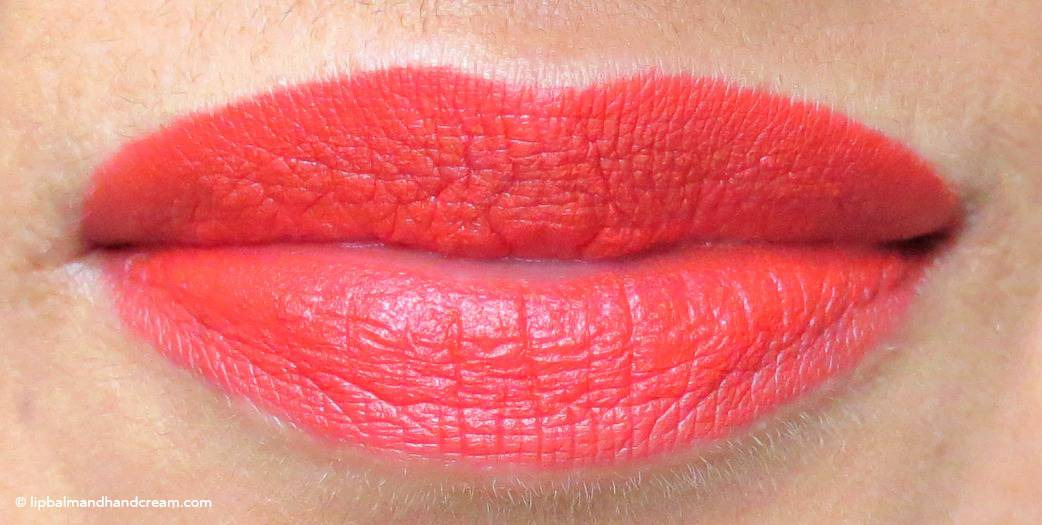 Illamasqua's lipstick in Liable - matt orange red